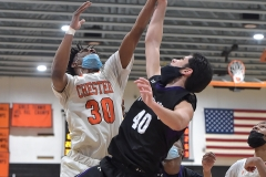 Chester's (30) Karell Watkins and Phoenixville's (40) Mike Memmo battle for a loose ball in the first half. THe Clippers went on to a 73-40 victory in PIAA DIstrict 1 semi-finals.