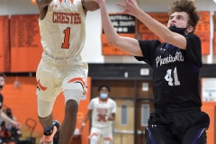 Chester's (1) Fareed Burton Jr. and Phoenixville's (41) JAckson Kuranda battle for a loose ball in the first half. THe Clippers went on to a 73-40 victory in PIAA DIstrict 1 semi-finals.
