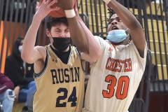 West Chester Rustin's (24) Ian Sleschsinger tries to keep control of the ball as Chester's (30) Karell Watkins goes for the steal in the third quarter. The Clippers went on to a 62-46 to win the District 1 title.