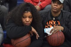 Nikera Brooks, mother of murdered Chester player Edward Harmon, and her mother Lisa Brooks, hold basketballs signed and presented to them by Chester players before the start of their PIAA state playoff game against Simon Gratz Wednesday evening at Cardinal O'Hara High School.