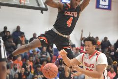 Chester's (4) Akeem Taylor dunks in the first quarter against Simon Gratz.
