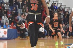 Chester's (30) Karell Watkins is the storngman after hitting a basket in the third qurter against Simon Gratz in PIAA playoffs at Cardinal O'Hara High School Wednesday night.