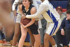 Villa Maria's Faith Iacone fights off three Mastery Charter School defenders in the second half  of PIAA playoffs Wednesay evening at Cardinal O'Hara High School. The Hurricane were victorious to advance to the next round of playoffs.