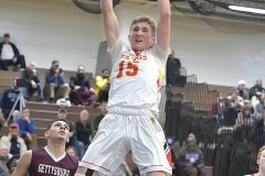 West Chester East's Andrew Carr brings the house down on this first half slam against Gettysburg in state playoffs at Norristown Area High School Friday night.