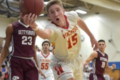 West Chester East's Andrew Carr saves a ball from going out of bounds in the second quarter against Gettysburg in state playoffs at Norristown Area High School Friday night.