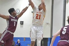 West Chester East's Tym Richardsonshoots from long range the third quarter as Gettysburg (1) Charles Warren defends in state playoffs at Norristown Area High School Friday night.