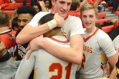 West Chester East's  Andrew Carr embrace sTym Richardson after he hit a three point shot with 1.8 seconds left on the clock to give the Vikings a 38-35 victory over Pottsville Tuesday evening at Reading High School in PIAA 5A playoffs.