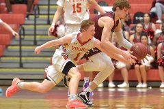 West Chester East's (1) Mike Dedda forces a turnover in the second half by Pottsville's Kevin Schrenk Tuesday evening at Reading High School in PIAA 5A playoffs.