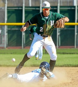 Bob Raines--Digital First Media Pennridge shortstop Dan Long can't get to the ball bouncing over the back of North Penn's Nate O'Donnell stealing second Apr 14, 2016.