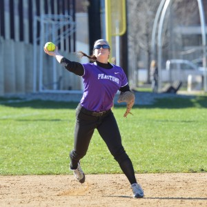 Phoenixville's Lainey Michaud throws to first to try and nab the Pope John Paul II runner during the late innings of Tuesday's 3-1 victory. (Sam Stewart - Digital First Media)
