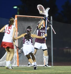 Radnor goalie Alexa Solomon makes one of her six saves during the Raiders' 12-8 win over Owen J. Roberts in the District One final Thursday night. (Digital First Media/Pete Bannan)