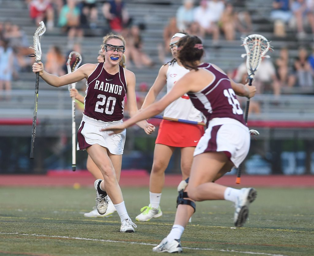 Radnor's Katie Quinn (20) celebrates her first period goal with Catherine Begier (16) Thursday night in the District One championship game against Owen J. Roberts at West Chester East High School. (Digital First Media/Pete Bannan)
