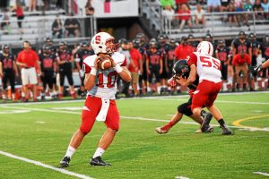 jeff davis — for digital first media Quarterback Joey Curotto gets ready to pass on Friday night.