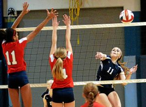 Bob Raines--Digital First Media North Penn's Victoria Smith avoids Plymouth Whitemarsh blockersTaylor O'Brien and Bridget McTamney Sept. 21, 2016.