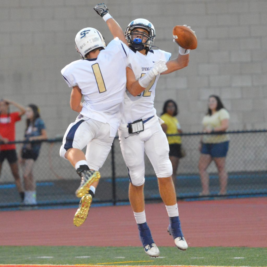 Spring-Ford's Stone Scarcelle celebrates after scoring a touchdown in the first half. (Sam Stewart - Digital First Media)