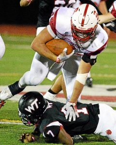 Bob Raines--Digital First Media Souderton's Koby Khan steps over William Tennent's Eddie North after shoving him to the ground Oct. 7, 2016.