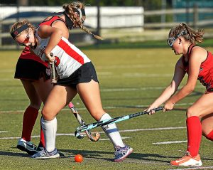 Bob Raines--Digital First Media  Upper Dublin's Allie DeMichele gets tangled up with Germantown Academy's Maddie O'Hara and Catherine McFadden Oct. 19, 2016.