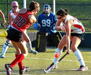 Bob Raines--Digital First Media  A shot by Germantown Academy's Colleen Carrigan catches Upper Dublin's Emma Kate Powell in the shin guard Oct. 19, 2016.