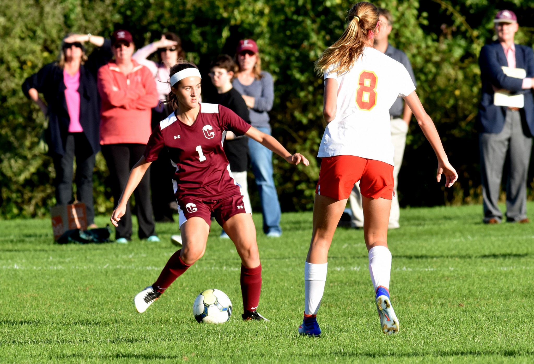 Conestoga's Caitlin Donovan, left, passes under pressure from Penncrest's Corryn Gamber during the teams' 2-2 draw Tuesday. (Digital First Media/Anne Neborak)