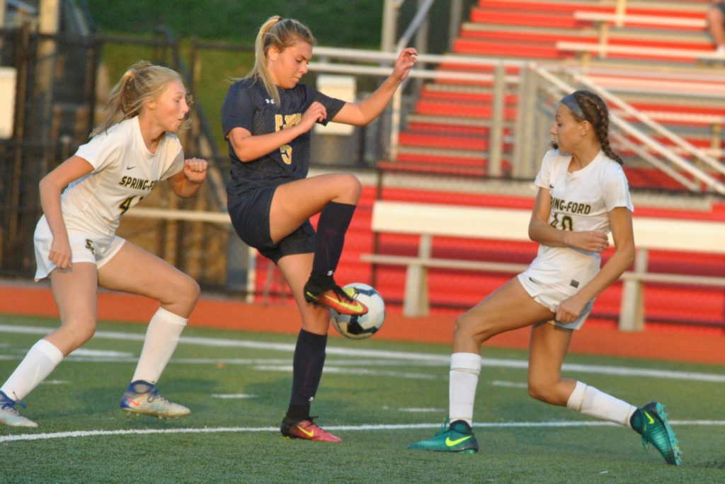 Pope John Paul II's Casey Genovese controls as Spring-Ford's Brynn Budka and Elle Kershner defend. (Barry Taglieber - For Digital First Media)