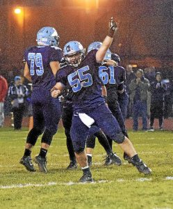 PETE BANNAN-DIGITAL FIRST MEDIA North Penn #55Matt Bevan celebrates the district title Friday night after the Knights 48-38 win over Garnet Valley at Crawford Stadium.