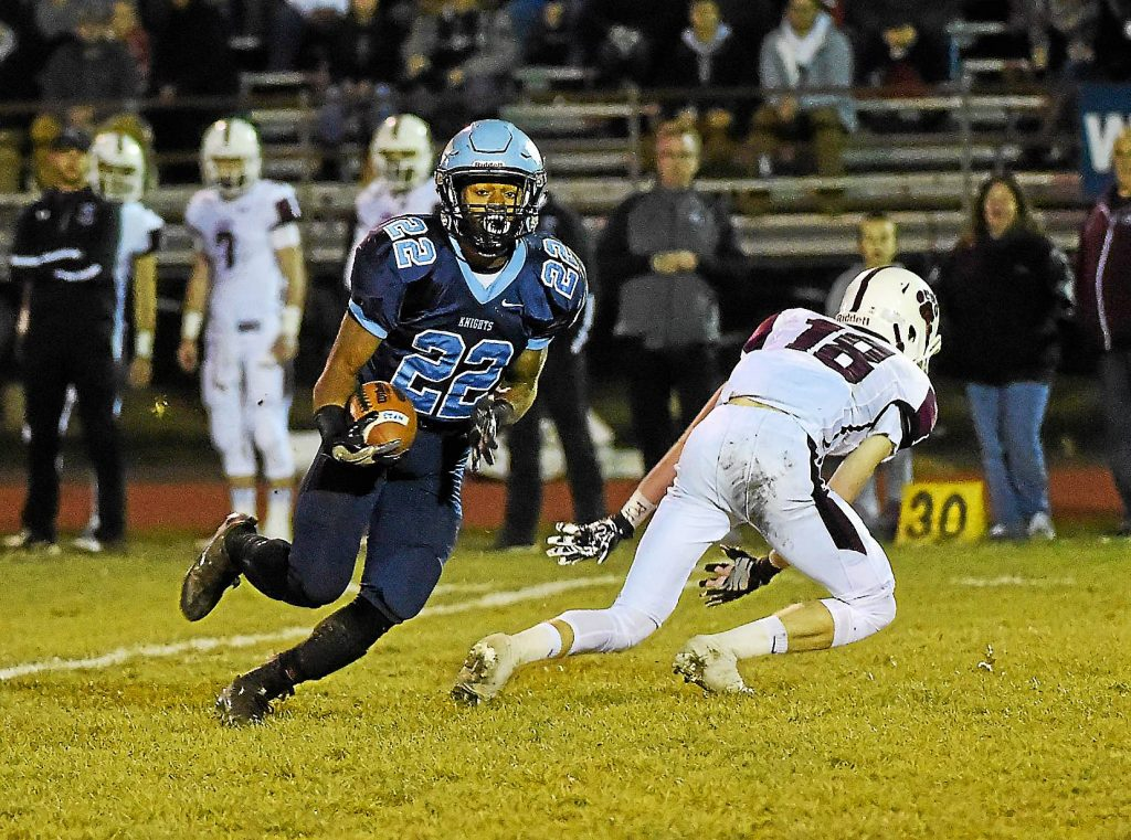 PETE BANNAN-DIGITAL FIRST MEDIA North Penn Knights #22 Nick DIllon takes a reception to the house in the first half of the District one final against Garnet Valley at Crawford stadium Friday evening.