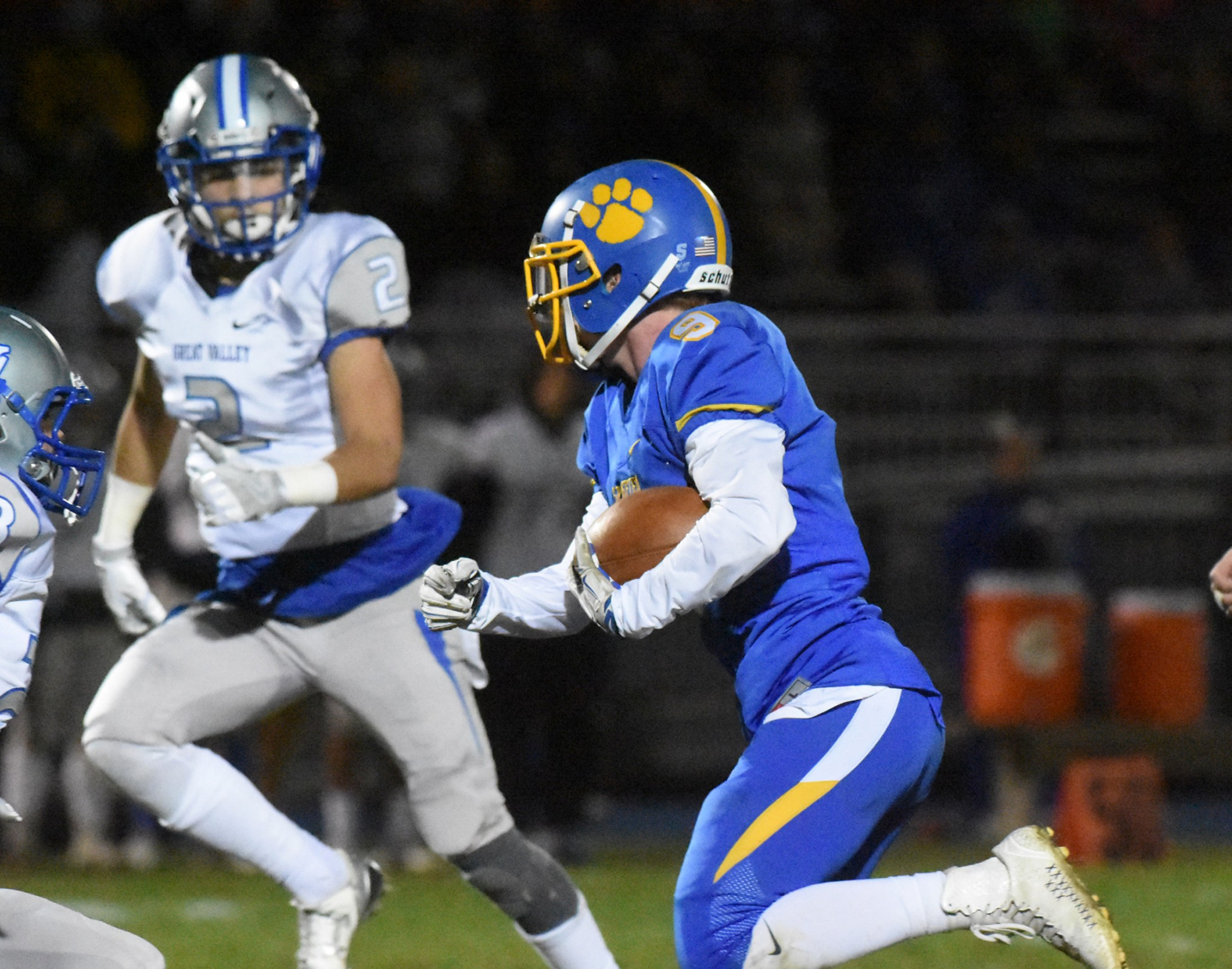 Springfield receiver Joe Kennedy tries to evade Great Valley defender Anthony Liberato during the Cougars' 24-10 win in a District 1 Class 5A quarterfinal game Friday night. (Digital First Media/Anne Neborak)