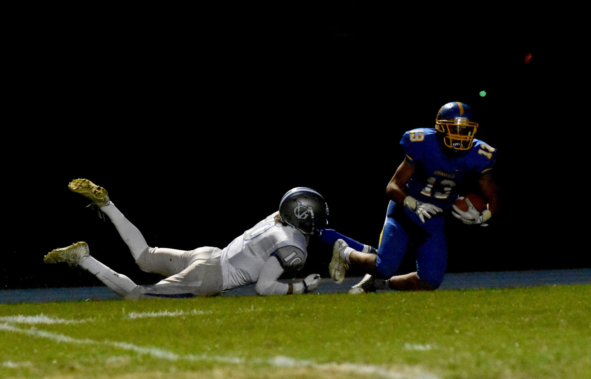 Great Valley's Brendan O'Donnell, left, provides a shoestring stop of Springfield's Ja'Den McKenzie at the one-yard line. McKenzie would score on the next play in a 24-10 win by the Cougars. (Digital First Media/Anne Neborak)