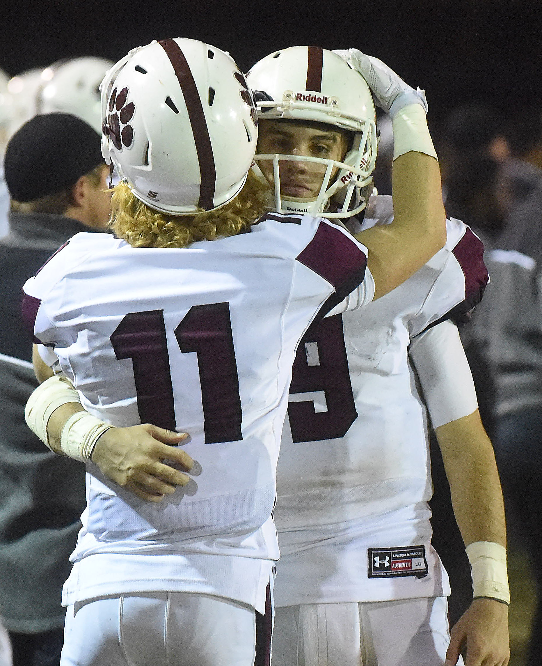 Garnet Valley quarterback Nick Juliano is embraced by wide receiver Matt Burba as time expires in the Jaguars' 48-38 loss to North Penn in Friday's District 1 Class 6A final. (Digital First Media/Pete Bannan)