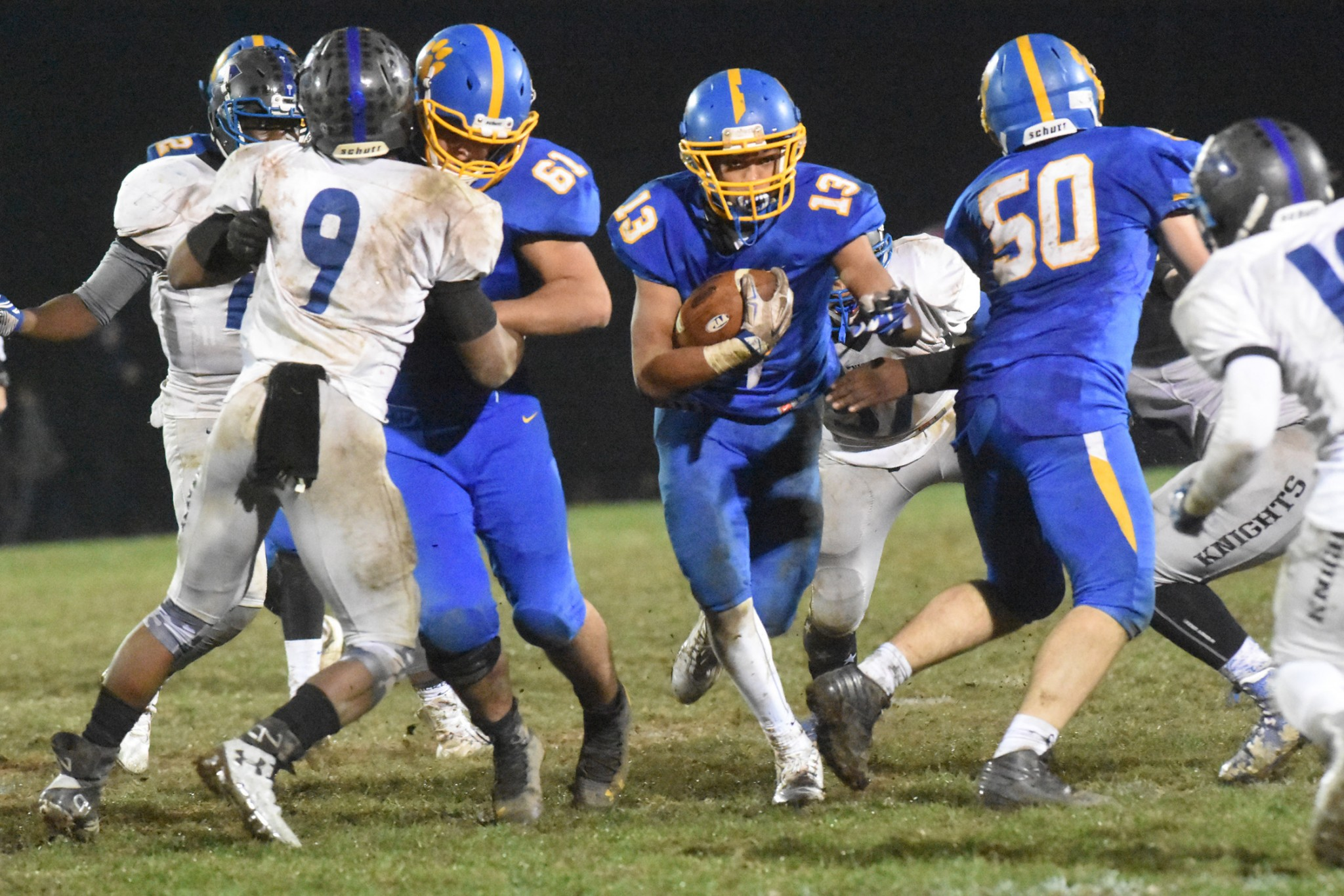 Springfield's Ja'Den McKenzie, who rushed for 167 yards and two touchdowns, breaks through the line for a big gain against Academy Park. (Digital First Media/Anne Neborak)