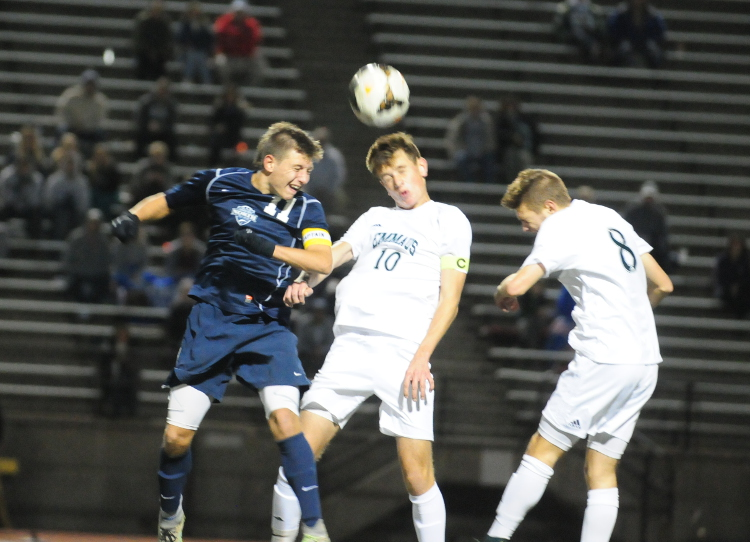 Council Rock North junior Conor O'Donnell, left, goes up for a header along with Emmaus senior Kacper Grycel (10) and junior Dakota Bauer in 2-1 overtime win that favored the Indians Tuesday night, Nov. 8 at J. Birney Crum Stadium in Allentown. (Steve Sherman – 21st-Century Media)
