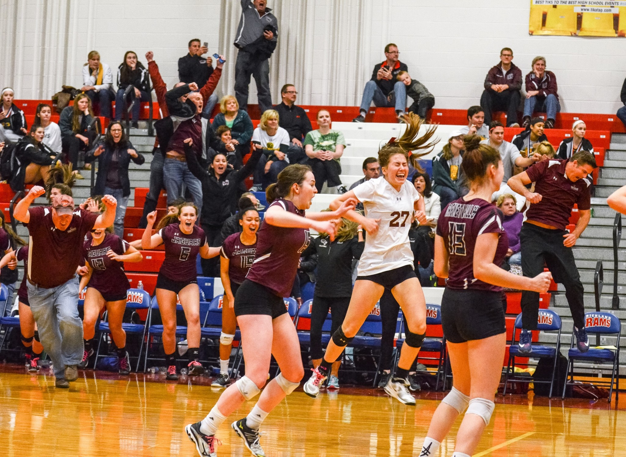 Garnet Valley players Meagan Scott (15), Lizzie Herestofa (27) and Sydney Portale (15) celebrate after the final point in Garnet Valley's 3-2 win over Parkland in the PIAA Class 4A volleyball final Saturday. (For Digital First Media/Tami Knopsnyder)