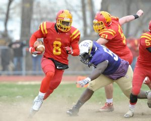 Haverford's Jordan Mosley (8) runs past Upper Darby's Derrick Korboi (51) during the first quarter Thursday. (Special to the Times / ERIC HARTLINE)