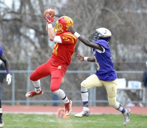 Haverford's Chris Trainor (21) catches a pass in front of Upper Darby's Nasir Greer (3) during the first quarter at Upper Darby High School. (Special to the Times / ERIC HARTLINE)