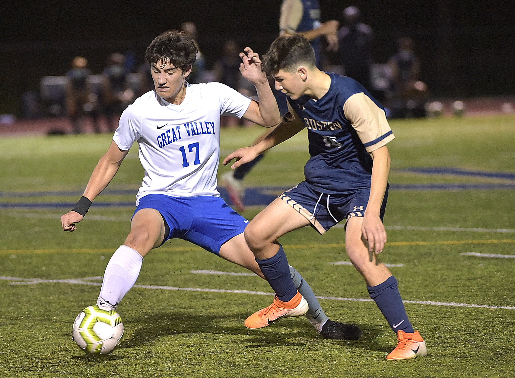 Great Valley's (17) Ethan Pfau and West Chester Rustin (16) Andy Saccomandi battle for a ball at Rustin.