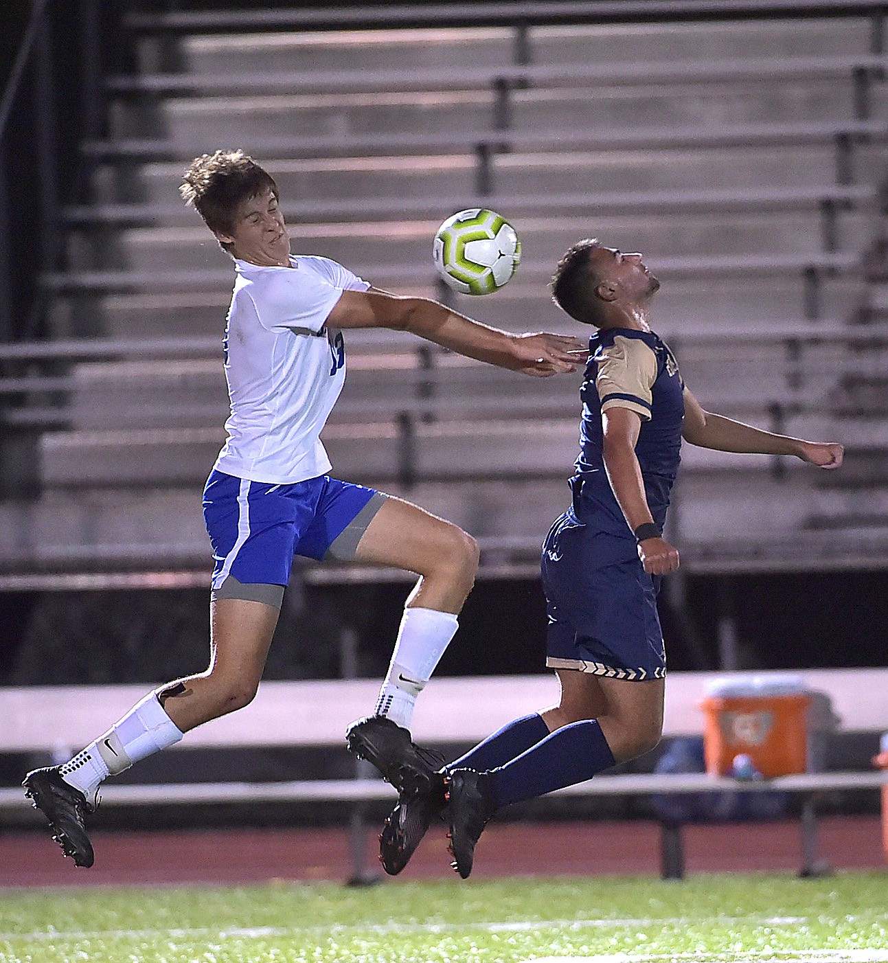 Great Valley's Karl Brandt (13) and West Chester Rustin's (9) Dimitri Makris battle for a ball in the first period.