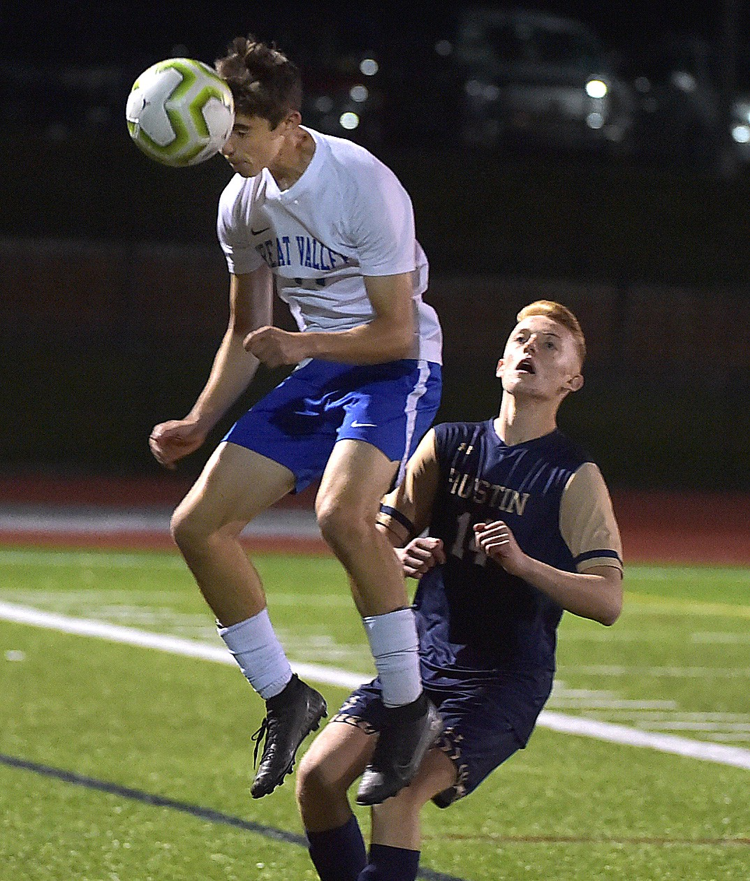 Great Valley defender (14) Freddie Marcks heads a ball out of bounds in front of Rustin Will Mason as the Patriots defeated the Golden Knights 1-0 on a goal by Karl Brandt.