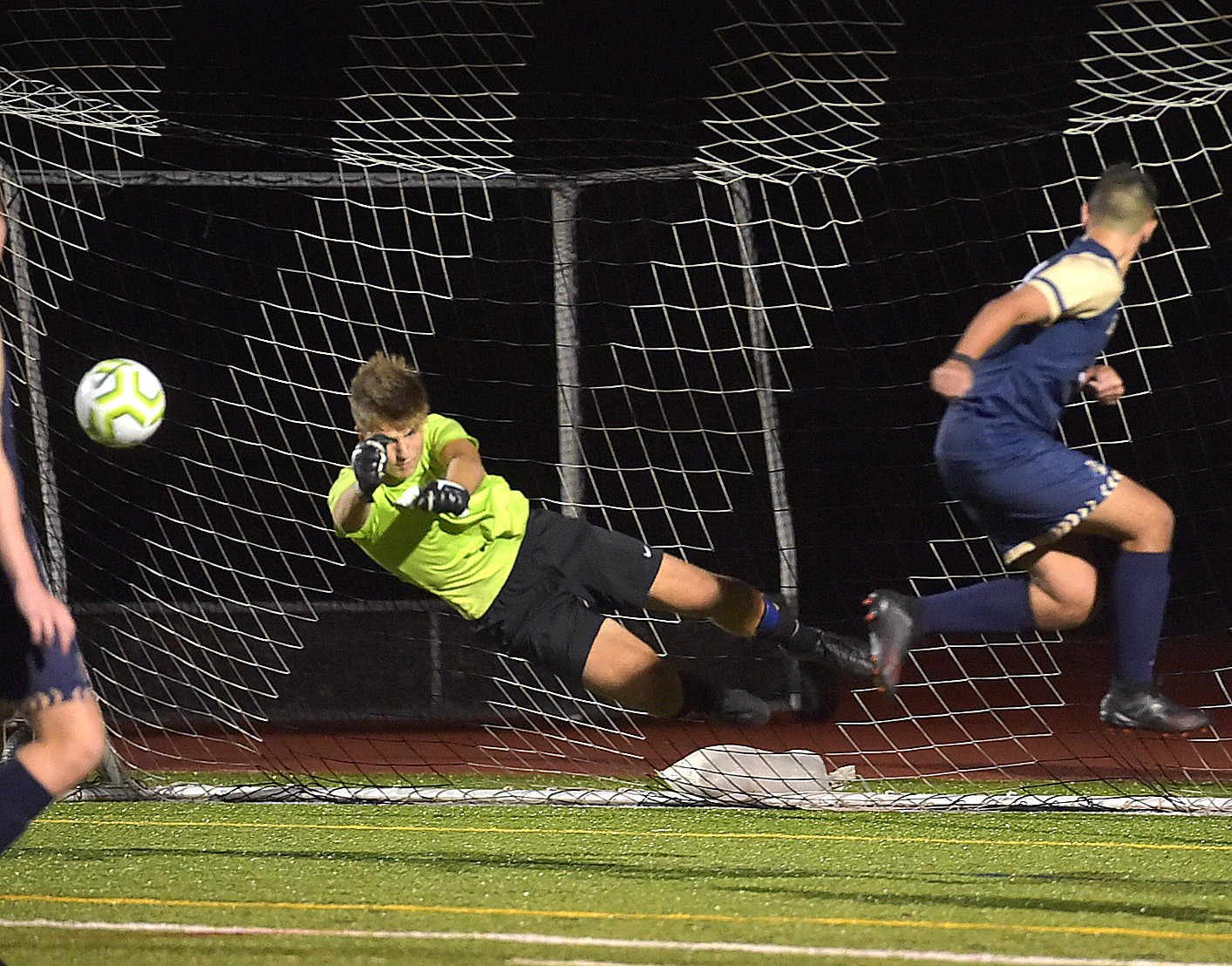 Great Valley goalkeeper Quinton Wrabley makes a save on a redirect byWest Chester Rustin's (9) Dimitri Makris in the second period as the Patriots defeated the Golden Knights 1-0 on a goal by Karl Brandt.