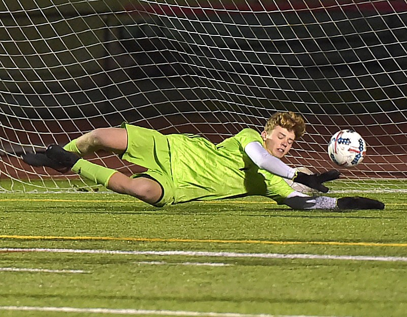 West Chester East goalie Trey Regester makes a save but couldn't hang on as Spring-Ford's (9) Justin Russell put the rebound past him to score the only goal in District playoff action at West Chester East Thursday night.