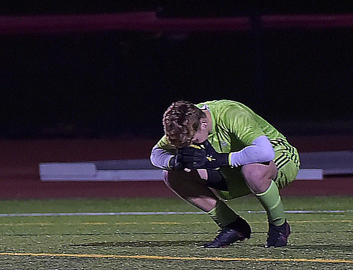 West Chester East goalkeeper (1) Tommy Regester reacts after Spring-Forddefeated the VIkings 1-0 in District playoff action at West Chester East Thursday night.