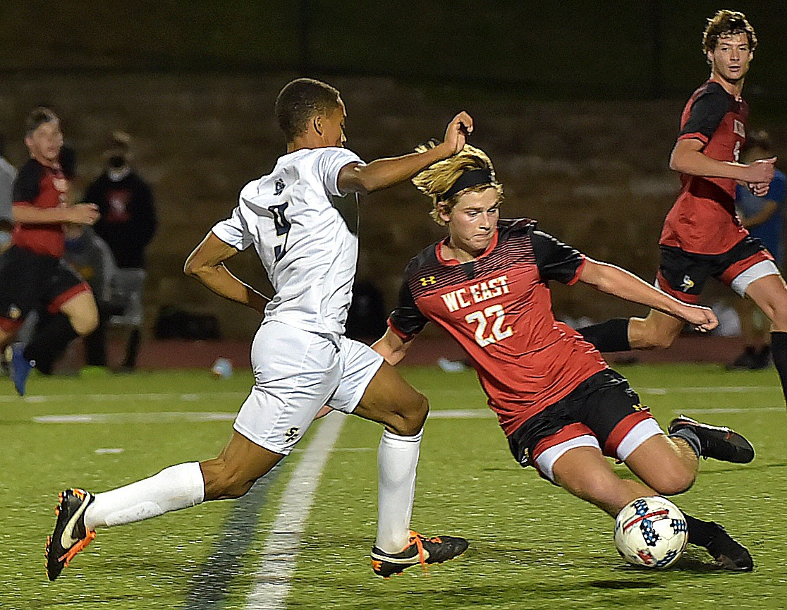 West Chester East defender (22) Trey Mullen makes a sweep block on Spring-Ford's (9) Justinb Russell in the second period of the game. Spring-Ford went on to win 1-0 in District playoff action at West Chester East Thursday night.