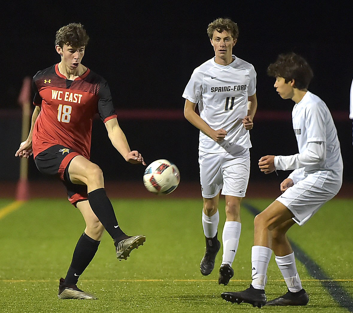 West Chester East forward (18) David Keith tries to move the ball against Spring-Ford in the first period. Spring-Ford went on to win 1-0 in District playoff action at West Chester East Thursday night.