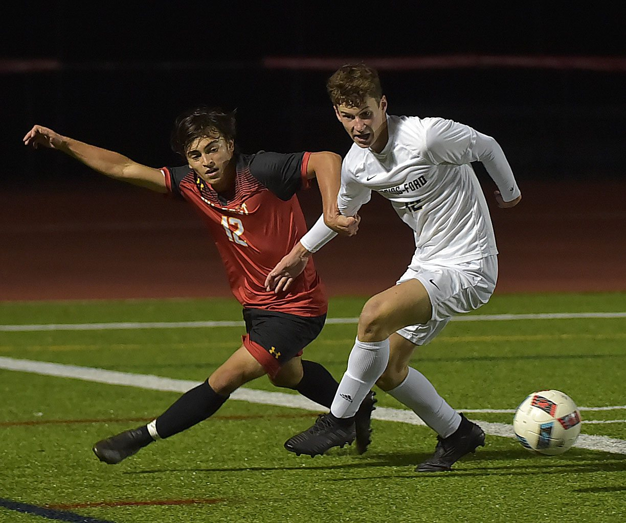 West Chester East forward (12) Vega Cruz is kept off the ball by Spring-Ford's (12) Brian Zisk late in the game. Spring-Ford went on to win 1-0 in District playoff action at West Chester East Thursday night.