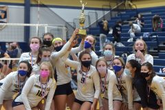 Unionville players hold up the the District 1- 4A  trophy in volleyball after defeating COuncil Rock North 3 games to 0 Thursday evening at Unionville High School.