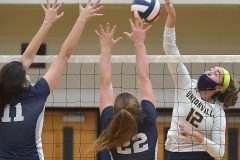 Unionville's (12) Sophie Brenner hits a ball in the second gaome of the District 1- 4A volleyball final against Council Rock North (11) Sabrina Pasemann and (22) Katlyn Logan Thursday evening at Unionville High School.