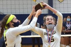 Unionville's (12) Sophie Brenner and (15) Ashlyn Wiswall hold up the the District 1- 4A  trophy in volleyball after defeating COuncil Rock North 3 games to 0 Thursday evening at Unionville High School.