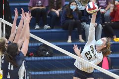 Unionville's (23) Jillian Murphy drills a ball against Council Rock North in the second game of the District 1- 4A  volleyball finals at Unionville High School.