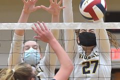 Unionville's (23) Jillian Murphy and (27) Emily Harper reject Council Rock North's (15) Mary Baniewicz in the first game of theDistrict 1- 4A  volleyball finals at Unionville High School.