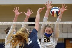 Unionville's (15) Ashley Wiswall and (28) Genna Weeber reject Council Rock North's (2) Ashleigh Adams  in the first game of theDistrict 1- 4A  volleyball finals at Unionville High School.