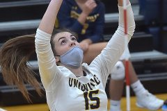 Unionville's (15) Ashley Wiswall sets a ball in game 2 against Council Rock North in the District 1- 4A  volleyball finals at Unionville High School.